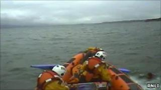 The lifeboat crew reach the kayaker