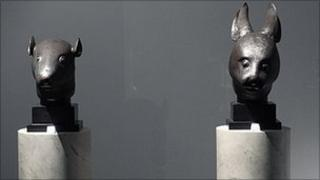 The statues of a rat's head and a rabbit's head, which China says were looted in 1860