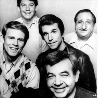 Tom Bosley (bottom) and the cast of Happy Days