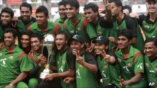 The triumphant Bangladeshis pose with their trophy in Dhaka on 17 October 2010