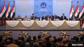 Iraqi oil officials attend the bidding in Baghdad