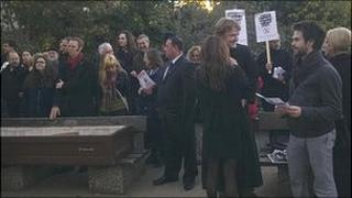 Protesters with a coffin in Reading