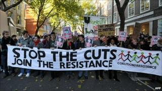 Demonstrators hold placards as they prepare to march towards Downing Street to protest over proposed goverment spending cuts, in central London [20 October 2010]