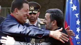 President Chavez embraces President Ahmadinejad in Tehran