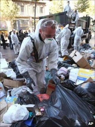 Members of the civil security service collecting rubbish in Marseille