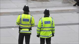 Police officers, pictured from behind