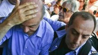 Jose Serra holds his head after being struck by an object on 20 October
