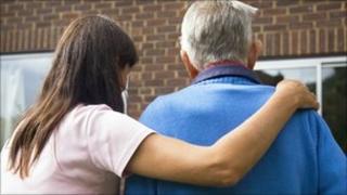 Woman helping an elderly man
