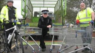 Police and council officers after the trolley clear-up