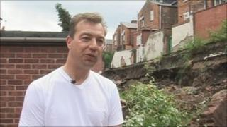 Andrew Pendleton outside his home