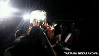Passenger Tatjana Nekazakova's photo shows commuters being walked out of a tunnel near Seven Sisters station