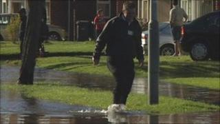 Residents walk through the flooded streets in Wolverhampton