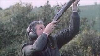 Man aiming shotgun