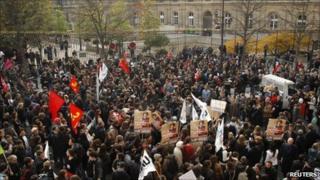 Demonstrators against pension reform gather outside the Senate in Paris, 26 October