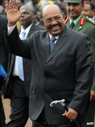 Sudanese President Omar al-Bashir waves as he arrives at the ceremony to mark the adoption Kenya's new constitution on 27 August 2010 in Nairobi