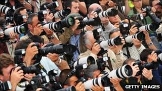 Photographers at a film event