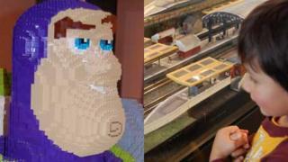 Buzz Lightyear and boy with train set
