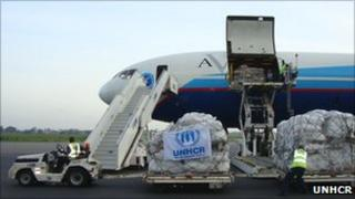 The first flight in a UNHCR emergency airlift to Benin lands at Cotonou international airport on Thursday 0520 local time