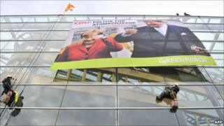 Greenpeace activists unfurl a protest banner on the Christian Democrat HQ in Berlin, 28 October