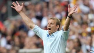 Jurgen Klinsmann encourages his team as they face Costa Rica in the 2006 World Cup