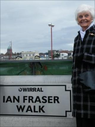 Melba Fraser with the new sign