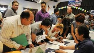 Unemployed Americans attend a job fair in California