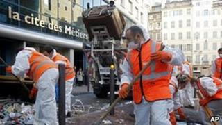 French waste collectors clean up a street in Marseille, 26 October