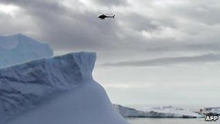 Helicopter flies above Antarctic ice in photo released in January 2007 by the French 'Institut Polaire' Paul Emile Victor (IPEV).