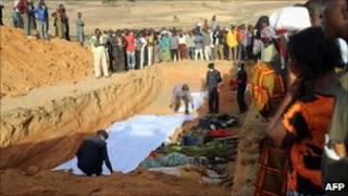 People of Dogo Nahawa, near Jos gather at the scene of a mass burial of their kinsmen killed during a religious crisis (file image from March 8, 2010)