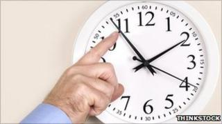 Man changing clock time