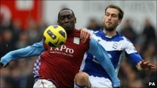 Aston Villa's Emile Heskey and Birmingham City's Roger Johnson