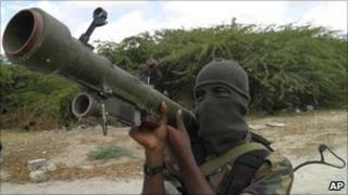 An al-Shabab fighter displays his weapon in northern Mogadishu, Somalia in October 2010