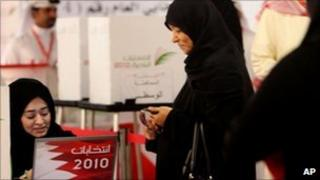 Voting in Muharraq, Bahrain on 30 October