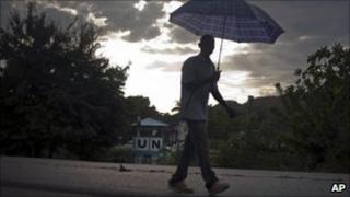 A man walks past Nepal's UN base in Mirebalais, Haiti.