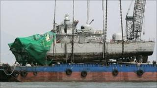 Cheonan being placed on a barge after a giant crane lifted it from the seabed (15 April)