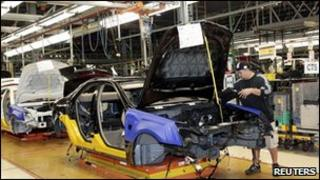 Worker on assembly line for GM Cadillac