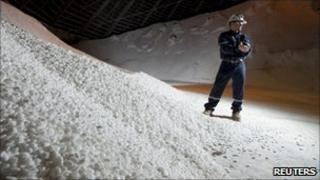 A Potash Corporation worker holding a handful of potash