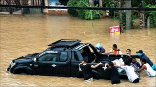 A truck being pushed through flood water on Ko Samui