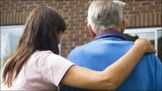 Woman helping elderly man