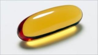A vitamin E capsule