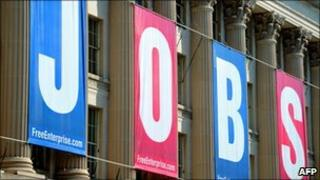 A jobs sign is seen on the front of the US Chamber of Commerce building