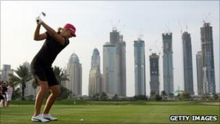 Anna Nordqvist tees off at the Dubai Ladies Masters, with the marina skyline in the background