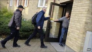 Police arrive to search the suspect's address in Malmo, 7 November