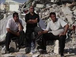 Israeli Arabs near the rubble of a mosque demolished by Israeli police in the Bedouin city of Rahat, southern Israel, 7 November