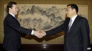 George Osborne, left, shakes hands with China's Vice Premier Li Keqiang