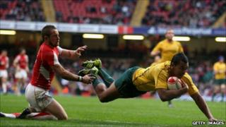 Wallabies full back Kurtley Beale beats Shane Williams to score during the Test match between Wales and Australia