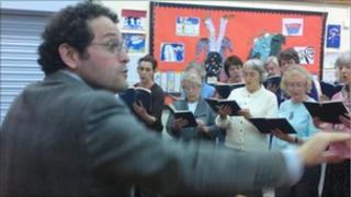 Marco Fanti with the choir