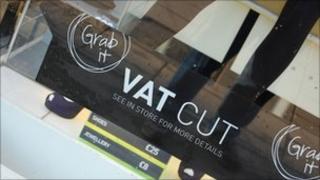 A sign advertising a VAT cut
