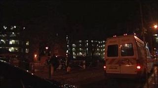 Police tape outside Strang House