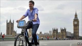 A man rides a cycle hire bike